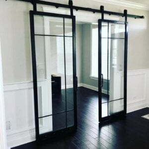 Barn door two glass partitions. Courtesy of G & M Ornamental Iron Work, Bartlett, IL