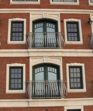 Finished balcony on brick building using FB-24 belly bars