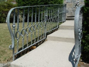 Exterior galvanized railing featuring wrought iron hand forged and tapered square picket with circular ribbon feature - P15C/06