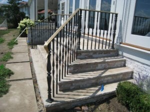 Wrought iron handcrafted post with curved profile - 7001320 exterior railing example at residence