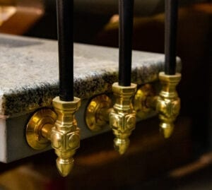 Brass side-mount bracket railing example with black balusters, on granite stairs - P1647B