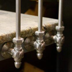 Stainless steel side-mount bracket brushed satin example on granite steps