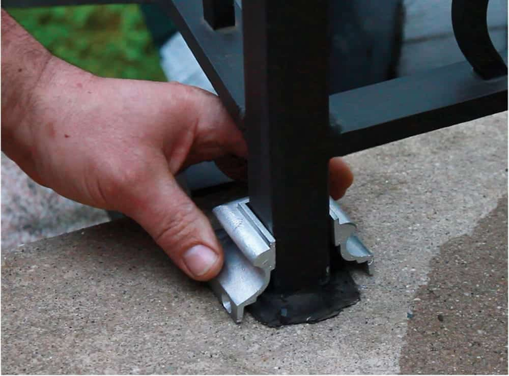 First installation step for split shoe, covering mismatched caulking around square post