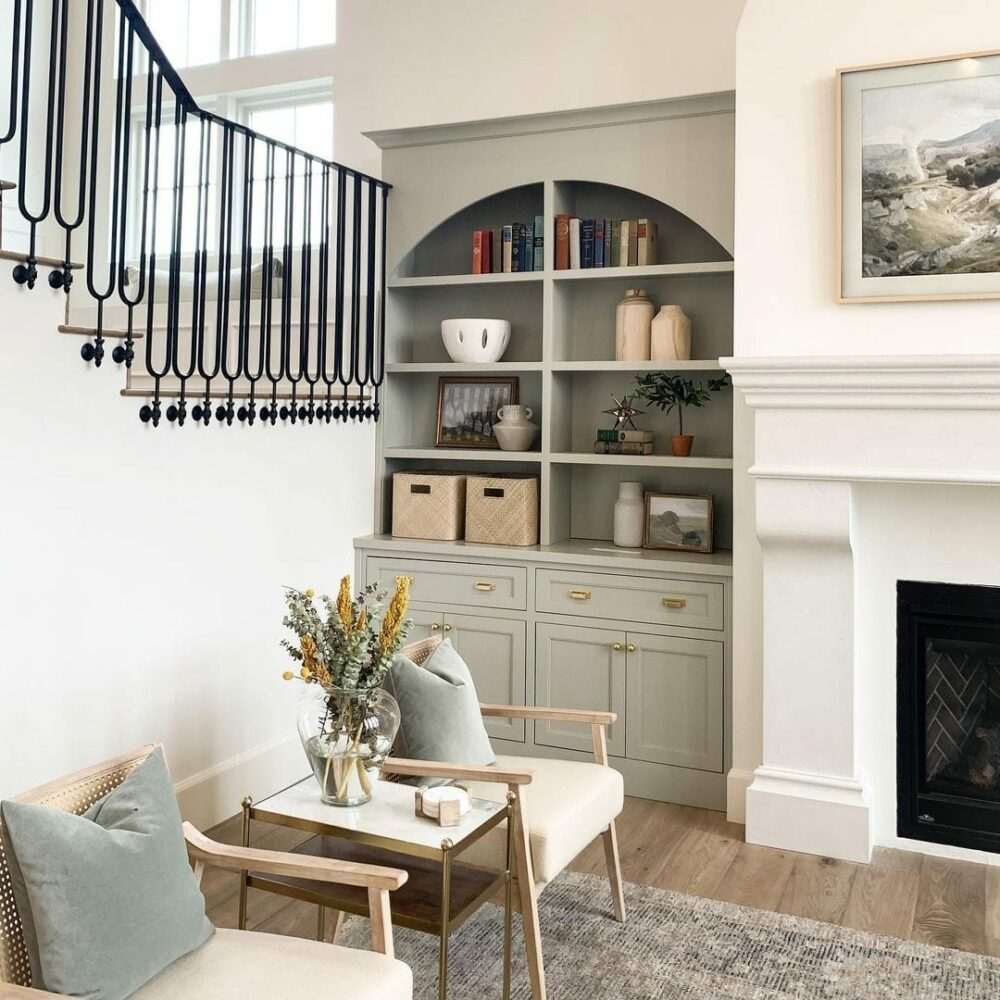 Side mount baluster bracket with modern stairs and decor in living room. close-up. Project by Ashley Webb Interiors.